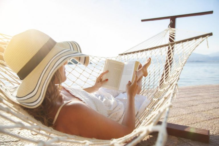 woman in hammock reading a book