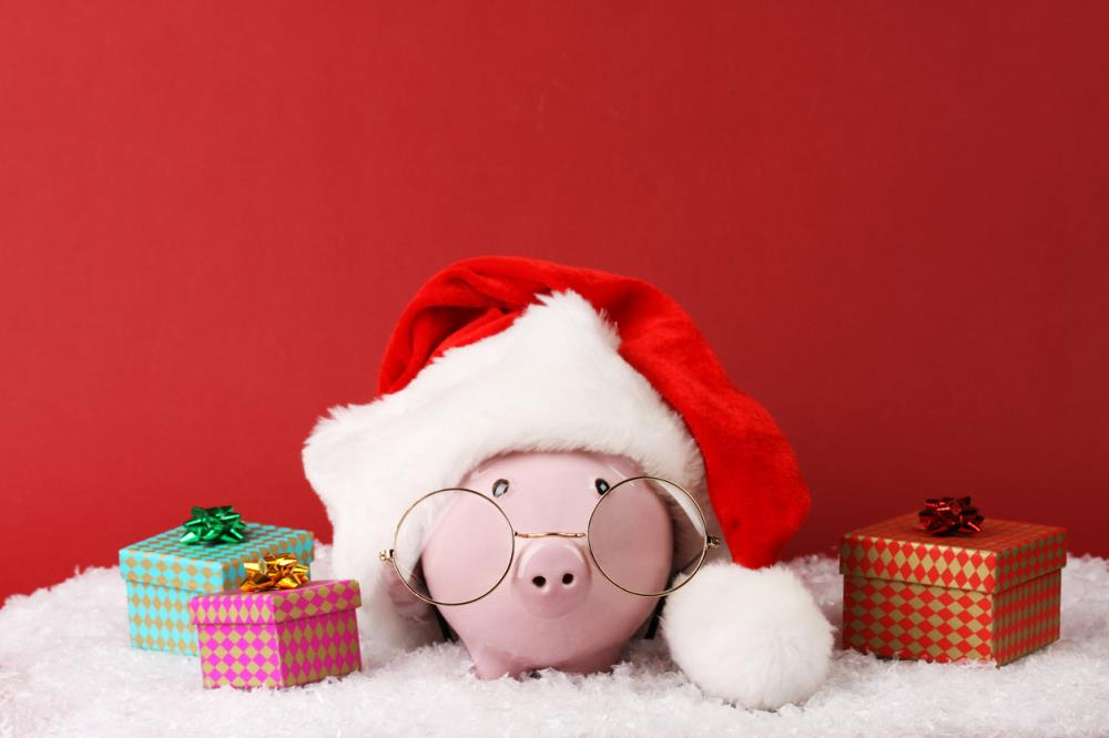piggy bank with Santa hat and presents